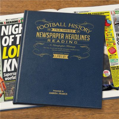 reading newspaper book blue leather cover